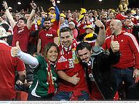 22 June 2013; British & Irish Lions supporters, from left, Lisa Halpin, from Douglas, Cork, Matt Crowley, from Blarney, Cork, and Rory Halpin, from Douglas, Cork, celebrate at the final whistle. British & Irish Lions Tour 2013, 1st Test, Australia v British & Irish Lions, Suncorp Stadium, Brisbane, Queensland, Australia. Picture credit: Stephen McCarthy / SPORTSFILE