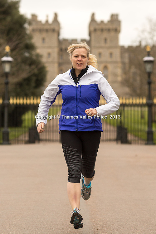 Detective Sergeant Fiona Pearce of Thames Valley Police is running the London Marathon to raise funds for Parkinson's UK. Pictured warming up at the start of The Long Walk in Windsor Great Park, Fiona's sponsorship target is &pound;1,000 of which has has raised &pound;600 already. She was inspired to run the Marathon on behalf of her father who has suffered from the disease for 20 years and who she cares for.   Windsor, UNITED KINGDOM. February 21 2013. <br /> Photo Credit: MDOC/Thames Valley Police<br /> &copy; Thames Valley Police 2013. All Rights Reserved. See instructions.