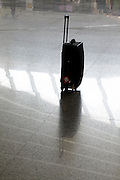 airport terminal with a suitcase without a person