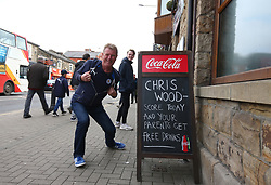 A Leicester City fans stands next to a sign outside a pub in Burnley during the Premier League match at Turf Moor, Burnley.