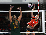 Tripoli's Natalie Figanbaum (7) tries to get the ball over LeMars Gehlen Catholic's Amber Timmins (15) during their 1A semifinal match in the state volleyball tournament at the U.S. Cellular Center at 370 1st Ave E on Friday evening, November 12, 2010. (Stephen Mally/Freelance)