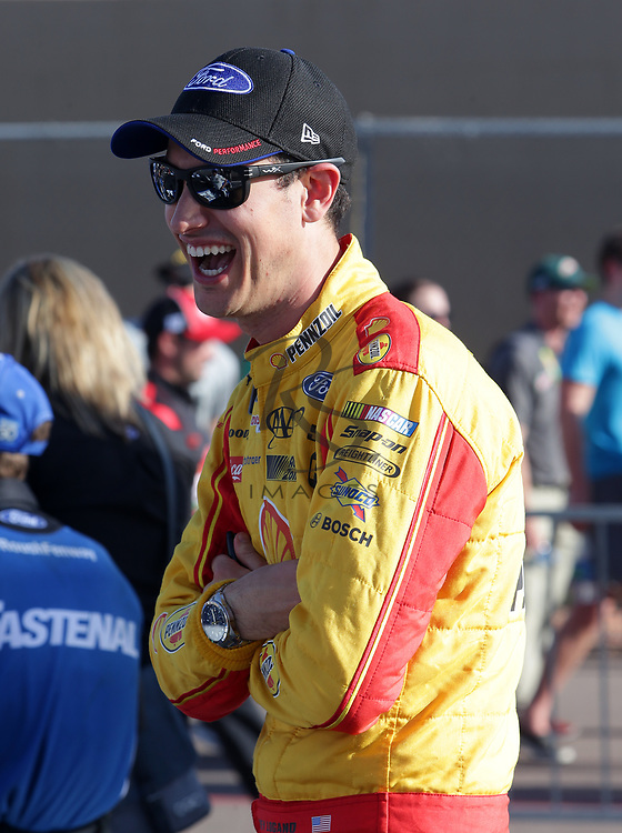 Joey Logano gets ready to qualify for Sunday's NASCAR Cup Series auto race on Friday, March 17, 2017, in Avondale, Ariz.  (AP Photo/Rick Scuteri)