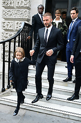 David Beckham and his children Harper (left), Romeo (camouflage jacket) and Brooklyn (rear, behind Romeo) leave after attending the Victoria Beckham London Fashion Week SS19 show in Dover Street, London.