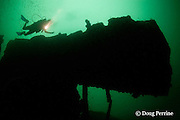 diver on the wreck of the Seian Maru, a Japanese cargo vessel sunk by Allied air strike on Nov. 19, 1944; the wreck lies on its port side at a depth of 25 m near Alava Pier in Olongapo Harbor, Subic Bay, Philippines; MR 379