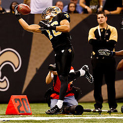 November 21, 2010; New Orleans, LA, USA; New Orleans Saints wide receiver Lance Moore (16) catches a pass over Seattle Seahawks cornerback Walter Thurmond (28) during the second half at the Louisiana Superdome. The Saints defeated the Seahawks 34-19. Mandatory Credit: Derick E. Hingle