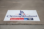 """LOS ANGELES, CA - APRIL 6:  A sign with the """"Opening Weekend"""" logo is stuck on the cement floor of the upper deck before the Los Angeles Dodgers game against the San Francisco Giants at Dodger Stadium on Sunday, April 6, 2014 in Los Angeles, California. The Dodgers won the game 6-2. (Photo by Paul Spinelli/MLB Photos via Getty Images)"""