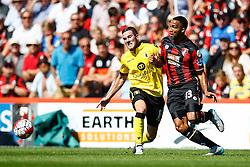 Callum Wilson of AFC Bournemouth passes under pressure from Jordan Veretout of Aston Villa - Mandatory by-line: Jason Brown/JMP - Mobile 07966 386802 08/08/2015 - FOOTBALL - Bournemouth, Vitality Stadium - AFC Bournemouth v Aston Villa - Barclays Premier League - Season opener