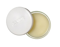 la mer open lip balm container photographed on a white background