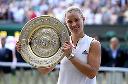 Angelique Kerber with the trophy on day twelve of the Wimbledon Championships at the All England Lawn Tennis and Croquet Club, Wimbledon.