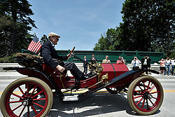 One of the first vehicles to pass the newly restored Willow Grove Avenue Bridge is the 1909 Hupmobile, driven by Joe Van Schrijver, of chestnut Hill. (Bastiaan Slabbers for NewsWorks)
