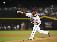 Aug. 10, 2012; Phoenix, AZ, USA; Arizona Diamondbacks pitcher Trevor Cahill (35) pitches during the game against the Washington Nationals  at Chase Field.  The Nationals defeated the Diamondbacks 9-1. Mandatory Credit: Jennifer Stewart-US PRESSWIRE