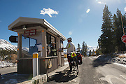 Ranger Parker Davis hooks gMack up with a Park map after threading the needle between Fall season storms and road closures - Yosemite National Park - Adventure Cycling Sierra Cascades Route - Canada to Mexico Cycling Expedition