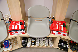 HAIFA, ISRAEL - Saturday, March 28, 2015: The shirts and boots for Wales' Aaron Ramsey and Gareth Bale in the dressing room ahead of the UEFA Euro 2016 qualifying Group B match against Israel at the Sammy Ofer Stadium. (Pic by David Rawcliffe/Propaganda)