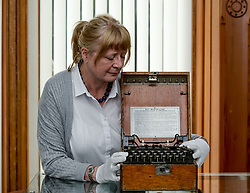 Pictured: Susan Bouwens from Bonham's in Glasgow with a very rare German Enigma code machine from 1941, expected to fetch up to &pound;150000 GBP at auction in October.<br /> <br /> &copy; Dave Johnston / EEm