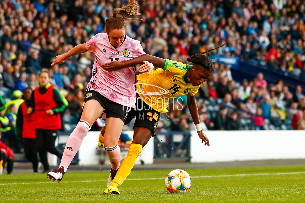 Scotlands Lisa EVANS (Arsenal WFC (ENG)) challenged by Deniesha BLACKWOOD (Univ. West Florida (USA)) during the International Friendly match between Scotland Women and Jamaica Women at Hampden Park, Glasgow, United Kingdom on 28 May 2019.
