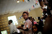 Isattu Jalloh, 11, at the Sunday Church service in Lunsar, Sierra leone. The girl is 7 months pregnant.