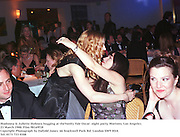 Madonna & Juliette Hohnen hugging at theVanity Fair Oscar  night party, Mortons, Los Angeles. 23 March 1988. Film 98169f18<br />