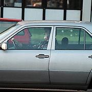 Anton Geesink in de auto bij het AZU Utrecht
