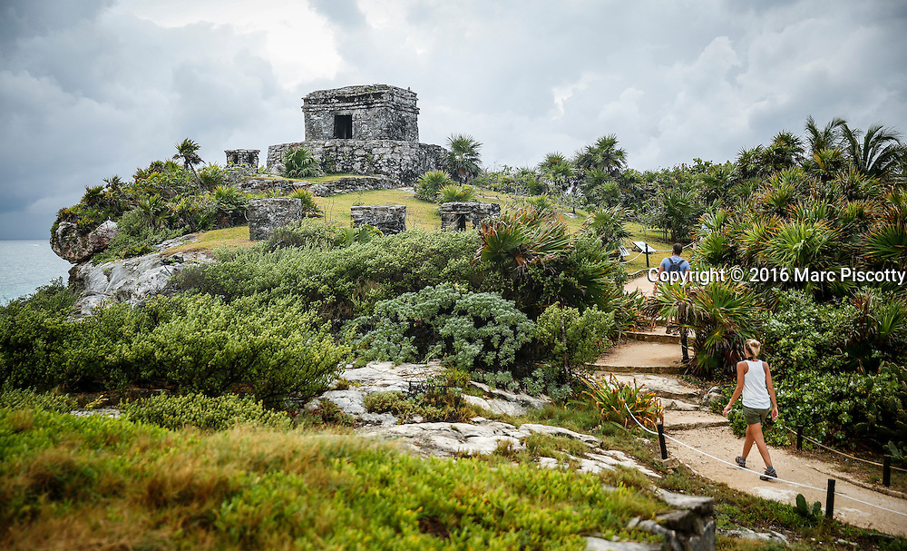 SHOT 12/10/16 7:46:25 AM - Tulum is the site of a pre-Columbian Mayan walled city serving as a major port for Cobá. The ruins are situated on 12-meter (39 ft) tall cliffs, along the east coast of the Yucatán Peninsula on the Caribbean Sea in the state of Quintana Roo, Mexico. Tulum was one of the last cities built and inhabited by the Maya; it was at its height between the 13th and 15th centuries and managed to survive about 70 years after the Spanish began occupying Mexico. Old World diseases brought by the Spanish settlers appear to have resulted in very high fatalities, disrupting the society and eventually causing the city to be abandoned. One of the best-preserved coastal Maya sites, Tulum is today a popular site for tourists. Tulum is located in the Mayan Riviera and along the east coast of the Yucatán Peninsula on the Caribbean Sea in the state of Quintana Roo, Mexico. (Photo by Marc Piscotty / © 2016)