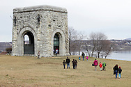 Newburgh, New York  - People walk toward the Tower of Victory monument at Washington's Headquarters State Historic Site  as part of George Washington's birthday celebration on Feb. 18, 2012. The monument was erected 1887 for the centennial of the end of the Revolution. Inside is a statue of Washington by William Rudolph O'Donnell, who also sculpted the officers of each branch on the parapet. The Hudson River is in the background at right.