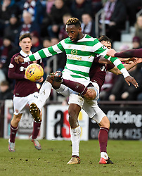 CelticÕs Moussa Dembele is tackled by Hearts Connor Randall during the Ladbrokes Scottish Premiership match at Tynecastle Stadium, Edinburgh.