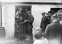 Miss Amelia Earhart - Atlantic Flyier at Derry. Outside Farmhouse - Signing Autographs.<br /> (Part of the Independent Newspapers Ireland/NLI Collection)
