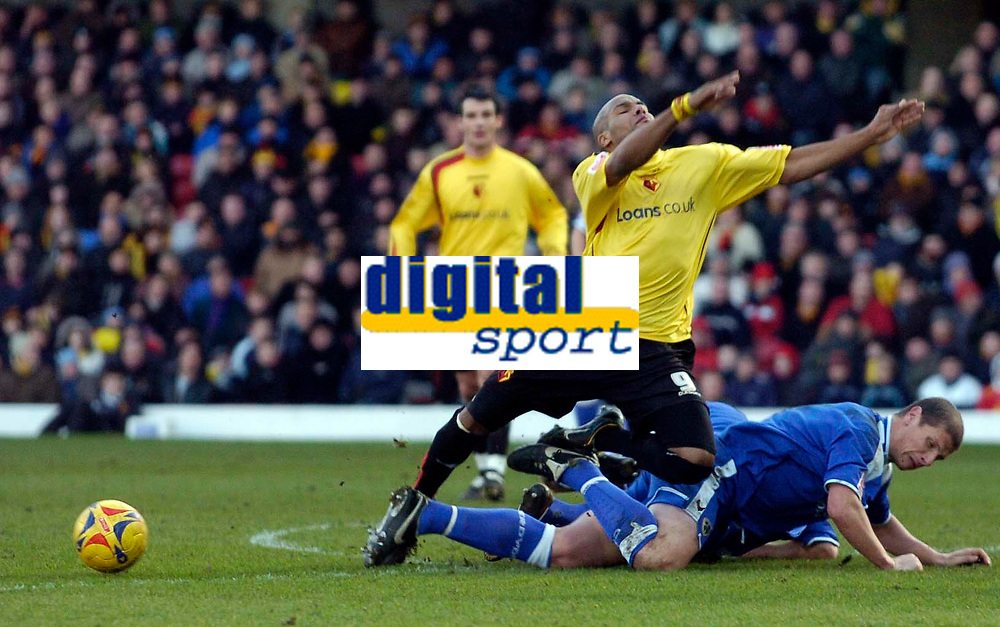 Photo: Alan Crowhurst.<br />Watford v Cardiff City. Coca Cola Championship. 25/02/2006. Watford's Marlon King is brought down by Neil Cox.