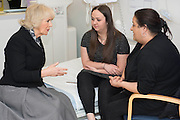 Her Royal Highness meets Charley Saunders, 18 from Poplar (pictured in black), and Danny Roberts, 13 from Maida Vale, on the ward. The Duchess of Cornwall, Patron, Arthritis Research UK, visits and meets patients of the Adolescent Inpatient Unit at University College London Hospitals.  •	Her Royal Highness then tours a laboratory at the Arthritis Research UK Centre for Adolescent Rheumatology and meeting researchers and supporters. London 12 Feb 2015.
