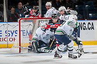 KELOWNA, CANADA - DECEMBER 7: Dillon Dube #19 of the Kelowna Rockets looks for the puck as he passes the front of the net of Rylan Toth #31 of the Seattle Thunderbirds on December 7, 2016 at Prospera Place in Kelowna, British Columbia, Canada.  (Photo by Marissa Baecker/Shoot the Breeze)  *** Local Caption ***