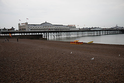 © Licensed to London News Pictures. 26/05/2014. Brighton, UK. Brighton beach lies virtually empty on bank holiday Monday. Heavy rain is expected to continue. Photo credit : Hugo Michiels/LNP