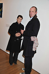 SOPHIE HICKS and JOHNNIE SHAND-KYDD at the launch of the Krug Happiness Exhibition at The Royal Academy, 6 Burlington Gardens, London on 12th December 2011.