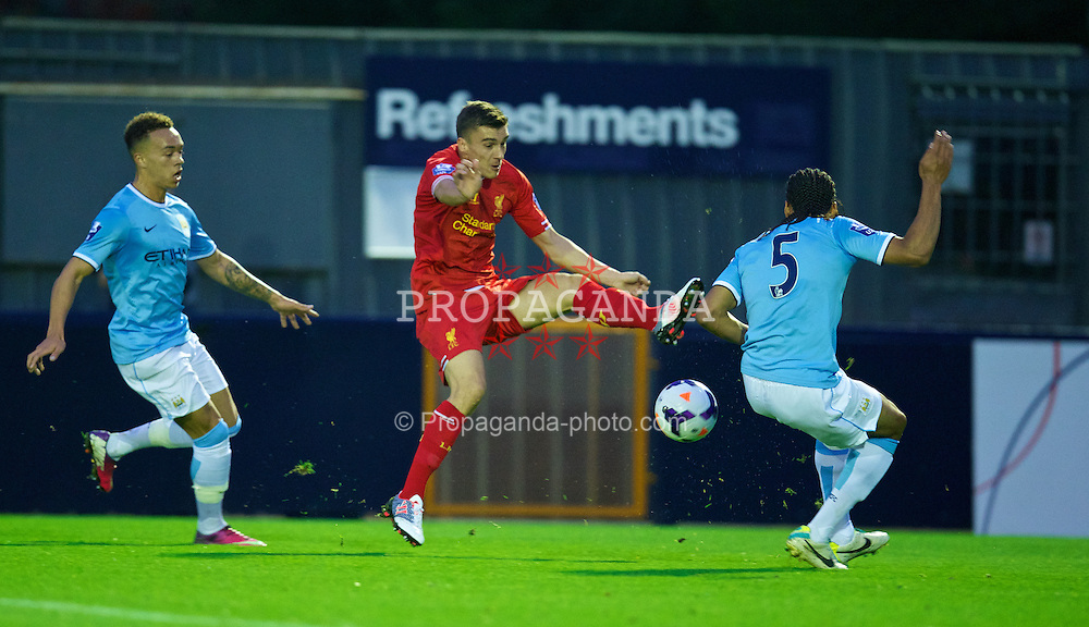 MANCHESTER, ENGLAND - Monday, September 23, 2013: Liverpool's Adam Morgan in action against Manchester City during the Under 21 FA Premier League match at Ewen Fields. (Pic by David Rawcliffe/Propaganda)