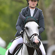 NORTH SALEM, NEW YORK - May 21: Ailish Cunniffe riding Casper in action during The $15,000 Under 25 T & R Development Grand Prix at the Old Salem Farm Spring Horse Show on May 21, 2016 in North Salem, New York. (Photo by Tim Clayton/Corbis via Getty Images)