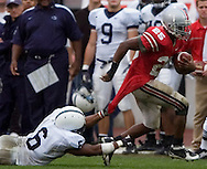 MORNING JOURNAL/DAVID RICHARD.Antonio Pittman is brought down from behind by Donnie Johnson of Penn State..