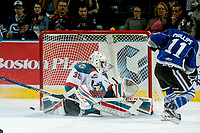 KELOWNA, CANADA - MARCH 11: Michael Herringer #30 of the Kelowna Rockets deflects a shot by Matthew Phillips #11 of the Victoria Royals on March 11, 2017 at Prospera Place in Kelowna, British Columbia, Canada.  (Photo by Marissa Baecker/Shoot the Breeze)  *** Local Caption ***
