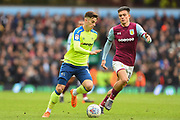 Derby County midfielder Tom Lawrence (10) with Aston Villa midfielder Jack Grealish (10) closing during the EFL Sky Bet Championship match between Aston Villa and Derby County at Villa Park, Birmingham, England on 28 April 2018. Picture by Jon Hobley.