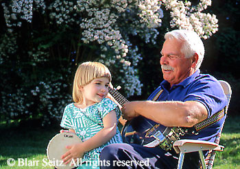 Active Aging Senior Citizens, Retired, Activities, Elderly Sing and Play Musical Instruments, Staying Young, Active Minds Grandfather Plays Guitar for Granddaughter, Child Plays Tambourine