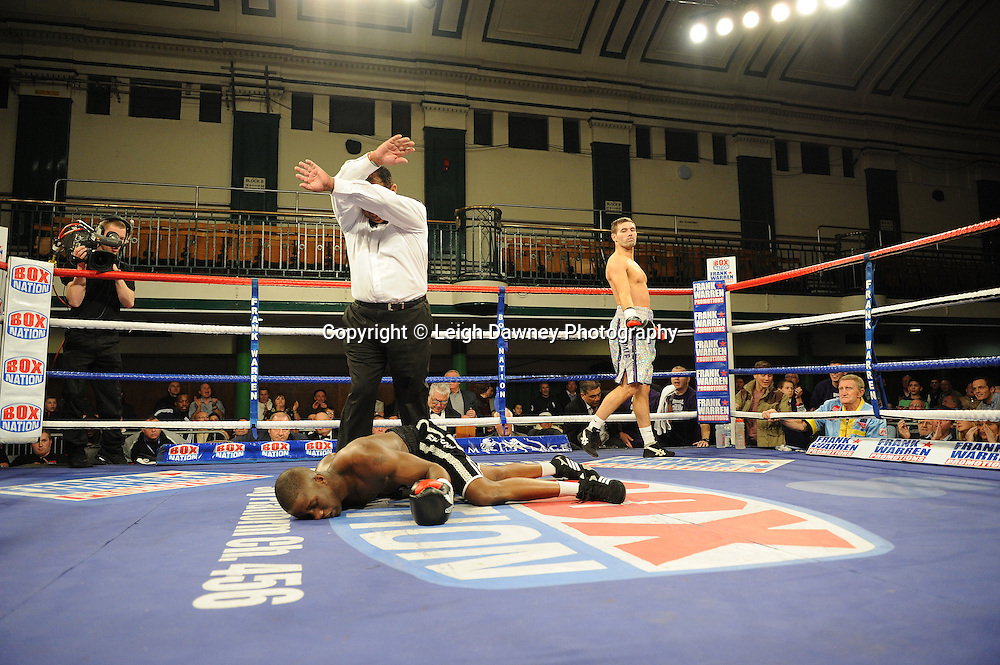 Steve O'Meara knocks out Nathan Weise (black shorts) in a 10x3 min rounds Southern Light Middleweight Championship at York Hall, Bethnal Green, London on 14th December 2011. Frank Warren Promotions. Photo credit: © Leigh Dawney 2011.