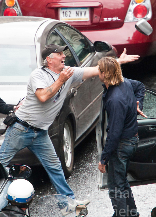 "Day two of filming. Brad Pitt throws his cars broken wing mirror to a crew member on the set of the movie ""World War Z"" being shot in the city centre of Glasgow. The film, which is set in Philadelphia, is being shot in various parts of Glasgow, transforming it to shoot the post apocalyptic zombie film.."
