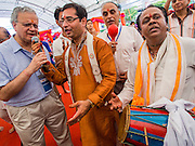 07 SEPTEMBER 2014 - BANGKOK, THAILAND: Men lead song and prayer during the Ganesh Festival at Central World in Bangkok. Ganesh Chaturthi, also known as Vinayaka Chaturthi, is a Hindu festival dedicated to Lord Ganesh. It is a 10-day festival marking the birthday of Ganesh, who is widely worshiped for his auspicious beginnings. Ganesh is the patron of arts and sciences, the deity of intellect and wisdom -- identified by his elephant head. The holiday is celebrated for 10 days, in 2014, most Hindu temples will submerge their Ganesh shrines and deities on September 7.     PHOTO BY JACK KURTZ