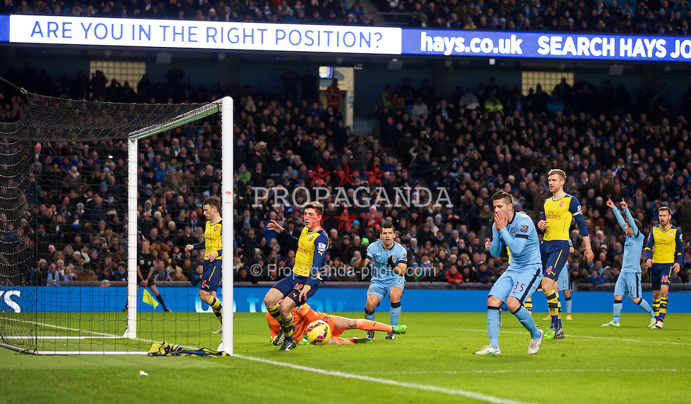 MANCHESTER, ENGLAND - Sunday, January 18, 2015: Manchester City's Stevan Jovetic looks dejected after missing a chance against Arsenal during the Premier League match at the City of Manchester Stadium. (Pic by David Rawcliffe/Propaganda)