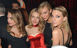 Left to right, CARA DELEVINGNE, NATALIA VODIANOVA, KARLIE KLOSS and TAYLOR SWIFT at 'The World's First Fabulous Fund Fair' in aid of the Naked Heart Foundation hosted by Natalia Vodianova and Karlie Kloss at The Roundhouse, Chalk Farm Road, London on 24th February 2015.