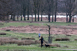© Licensed to London News Pictures. 30/03/2020. London, UK. Runners exercise in a near empty Richmond Park as increased police patrols and the Government's social distancing message to say at home gets through to the wider public: As Downing Street chief aide, Dominic Cummings goes into self-isolation as the coronavirus crisis continues. Photo credit: Alex Lentati/LNP