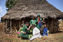 Leyualem Mucha, 14, has her hair trimmed behind her home in preparation of her wedding in the Amhara Region, Ethiopia on May 23, 2007. Leyualem had never met her husband before her wedding day, yet sumitted as they bound her in the white wedding cloth. The men later said it was placed over her head so she would not be able to find her way back home, should she want to escape the marriage.