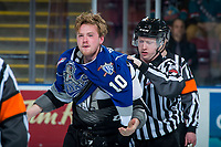KELOWNA, CANADA - FEBRUARY 12:  Lineman Cody Wanner escorts Braydon Buziak #10 of the Victoria Royals to the dressing room after a major fighting penalty against the Kelowna Rockets on February 12, 2018 at Prospera Place in Kelowna, British Columbia, Canada.  (Photo by Marissa Baecker/Shoot the Breeze)  *** Local Caption ***