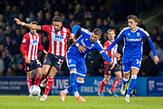 Lincoln City midfielder Bruno Andrade (11) and Gillingham FC defender Max Ehmer (5)  during the EFL Sky Bet League 1 match between Gillingham and Lincoln City at the MEMS Priestfield Stadium, Gillingham, England on 16 November 2019.