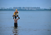 Ganesh Festival, the most important of Mumbay, when more than 15.000 statues of this elephant-god are  submerged in the sea at Chowpatty Beach.