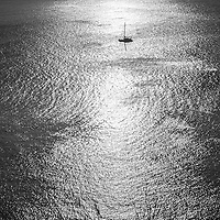 Thailand.<br /> I love this small yacht on the sliver sea. In a way gives us a feeling of emptiness and tranquility.