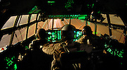 (Left - right) Major. John Eric Hall, pilot; Tech. Sgt. Craig Schueller, flight engineer; Capt. Tim Pemberton, co-pilot, land their C-130H3 at an undisclosed location, completing a combat support mission. The reservists are deployed to the 746th Expeditionary Airlift Squadron.  Major Hall and Capt. Pemberton are stationed with the 731st Airlift Squadron, Peterson Air Force Base, Colorado. Tech. Sgt. Schueller is stationed with the 95th Airlift Squadron, General Mitchell Air Reserve Base, Wis. Hall and Pemberton are natives of Colorado Springs, Co. and Schueller is a native of Juneau, Wis. (U.S. Air Force photo by Master Sgt. Lance Cheung)<br />