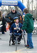 Terry Wines, receives assistance from her sister Sherry Dawson and her medal of participation from her son Jared during the 2009 5K Frostbite Run held at Ohio University February 29, 2009.